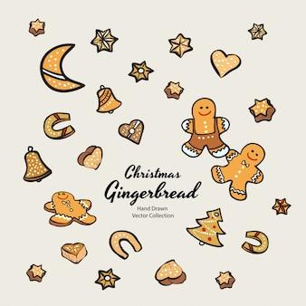 Biscoitos de gengibre de natal conjunto ilustração desenhada mão. vintage tradicional assar biscoitos de esmalte de maçapão de natal. biscoitos de pão de gengibre isolado.