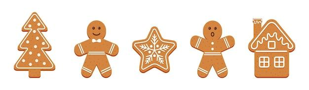 Biscoitos de natal de gengibre. biscoitos fofos de natal. homens clássicos do pão de gengibre, árvore, floco de neve e casa