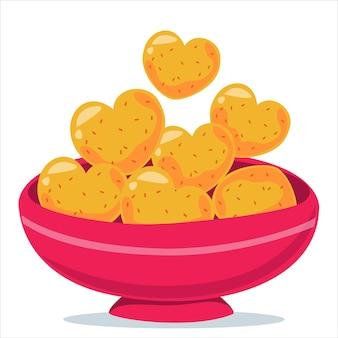Biscoitos em forma de coração. assar em uma tigela. ilustração vetorial no estilo cartoon