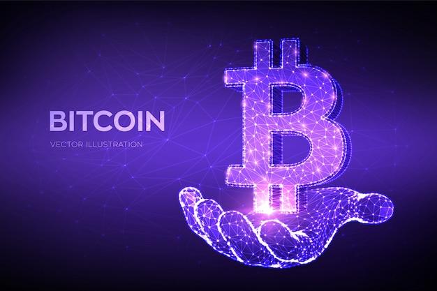 Bitcoin. linha de malha abstrata poligonal baixa e ponto bitcoin assinam na mão.