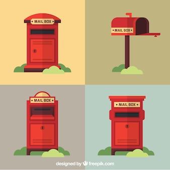 Bloco de quatro caixas de correio vermelhas no estilo do vintage