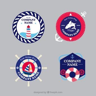 Bloco de quatro emblemas coloridos com elementos náuticos
