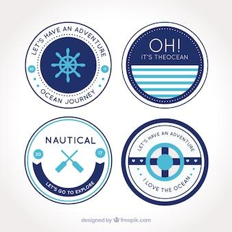 Bloco de quatro emblemas redondos náuticas