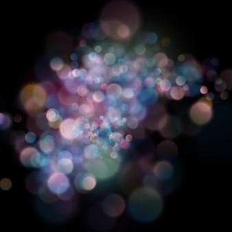 Bokeh circular desfocado abstrato da cor no fundo escuro.