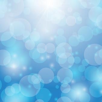 Bokeh criado e raio de luz no fundo abstrato azul