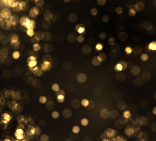 Bokeh ouro turva luz sobre fundo preto. luzes douradas e modelo de férias de ano novo. resumo brilho defocused piscando estrelas e faíscas.