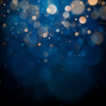 Bokeh turva luz sobre fundo azul escuro. feriados de natal e ano novo. resumo brilho defocused piscando estrelas e faíscas.