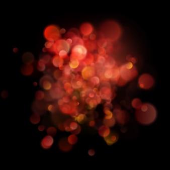 Bokeh vermelho circular desfocado abstrato em fundo escuro.