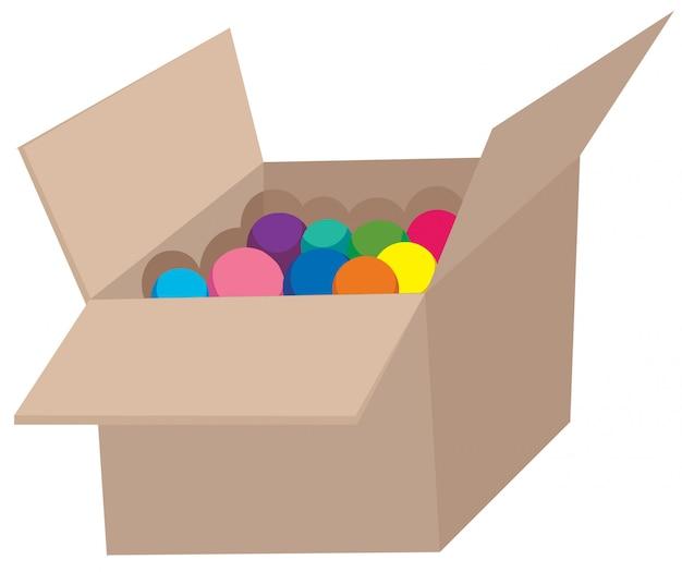 Bola colorida em caixa de papelão ondulado