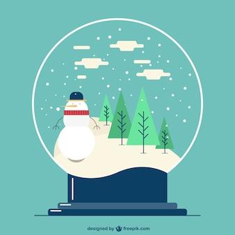 Bola de cristal com paisagem do inverno