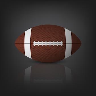 Bola de futebol americano com reflexo em um fundo preto.