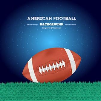Bola de futebol americano na grama