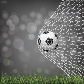 Bola de futebol de futebol no gol de futebol com luz turva bokeh de fundo.