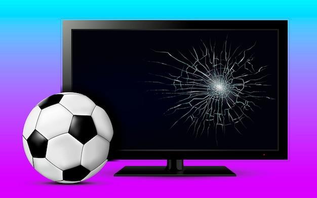 Bola de futebol e tela de tv quebrada