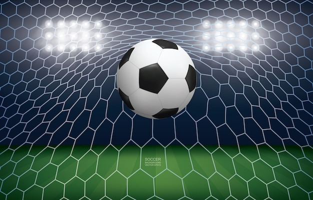 Bola de futebol no gol. bola de futebol e rede branca no fundo do estádio do campo de futebol.