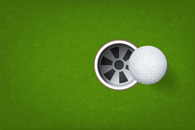 Bola de golfe e buraco de golfe.