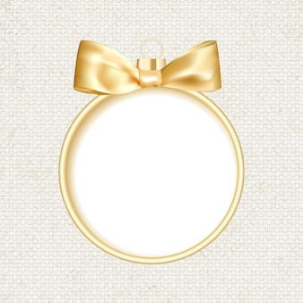 Bola de natal dourada em fundo cinza.