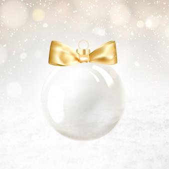 Bola dourada de natal com faíscas desfocadas