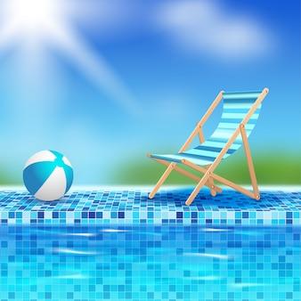 Bola e cadeira à beira da piscina