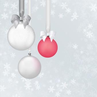 Bolas de brinquedo de natal no fundo do floco de neve