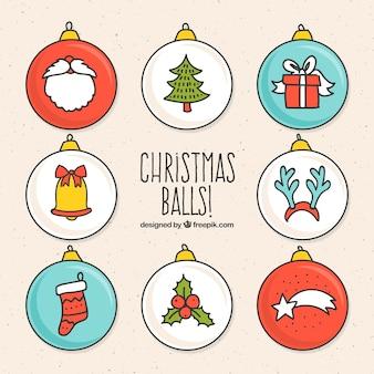 Bolas decorativas com elementos do natal desenhados à mão