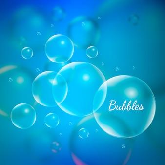 Bolhas do aqua da água no fundo azul.
