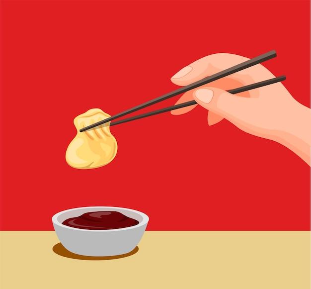 Bolinho de mão com pauzinho para sauce.traditional comida chinesa símbolo na ilustração dos desenhos animados