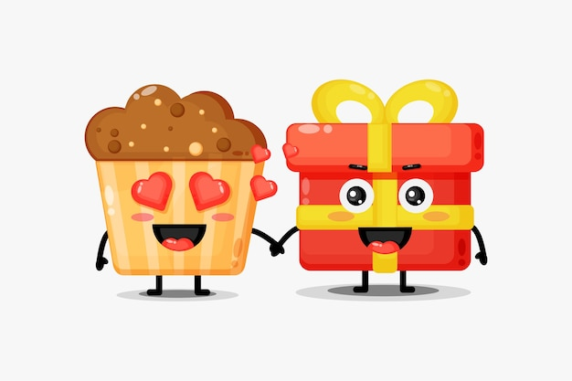 Bolinhos fofos e mascote de caixas de presente de mãos dadas