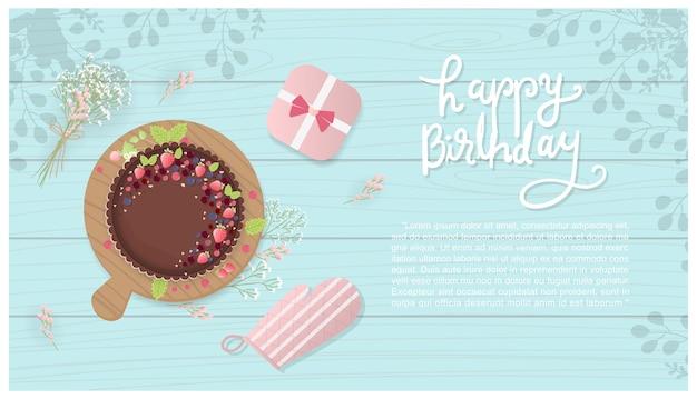 Bolo de aniversário de chocolate e bagas com caixa de presente, luvas de cozinha e flores
