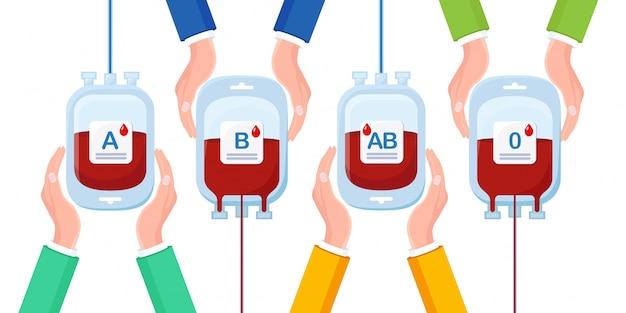 Bolsa de sangue com gota vermelha em mãos isoladas
