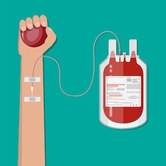 Bolsa de sangue e mão do doador