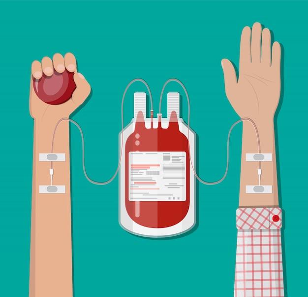 Bolsa de sangue no suporte e mão do doador