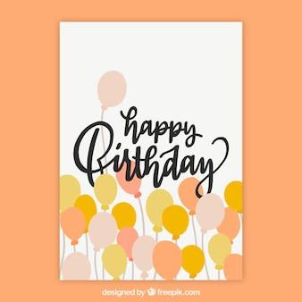 Bom cartão de aniversário desenhado à mão com balões amarelos e laranja