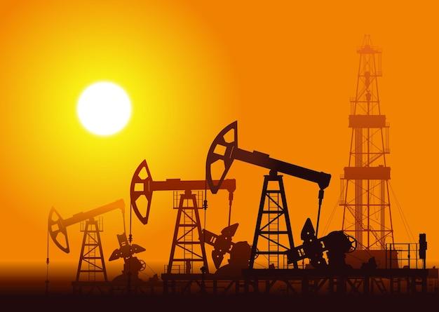 Bomba de óleo e equipamento sobre ilustração do pôr do sol