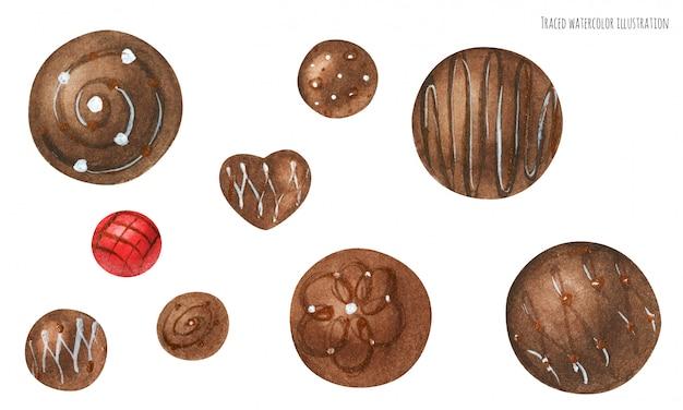 Bombons de chocolate decorados com glacê branco e dourado