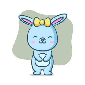 Boneca coelho usando fita amarela na cabeça entre as orelhas