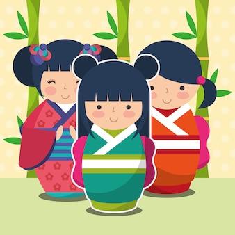 Boneca kokeshi japonesa de giro do grupo em quimono