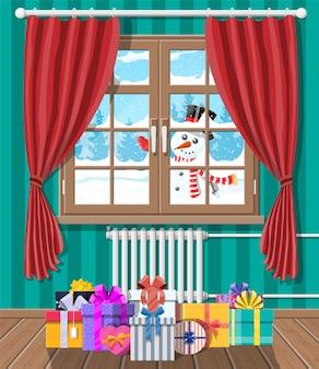 Boneco de neve olhando pela janela da sala