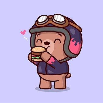 Bonito bebê marrom urso com equipamento de biker está sentindo tão feliz ao comer um delicioso hambúrguer