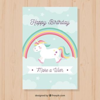 Bonito cartão de aniversário com unicórnio e arco-íris