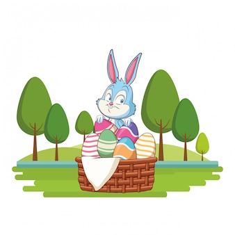 Bonito coelhinho da páscoa celebração ovo cesta natureza fundo árvores