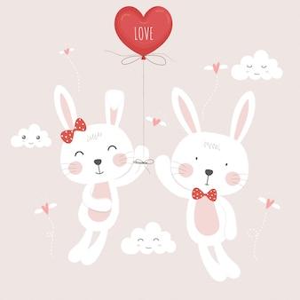 Bonito em coelhos amados com balão.
