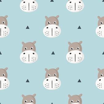 Bonito padrão sem emenda com hipopótamo de bebê dos desenhos animados para crianças. animal no fundo azul.