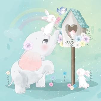 Bonito pequeno elefante e coelho brincando com um pássaro