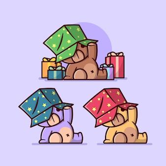 Bonito urso pequeno vestido uma caixa de presente na cabeça