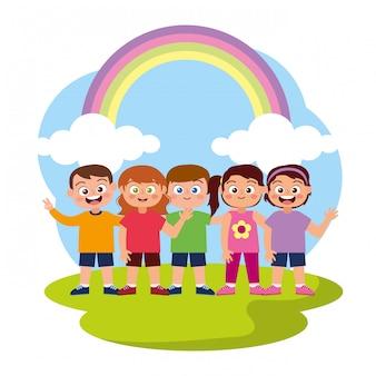 Bonitos crianças felizes com arco-íris e nuvens