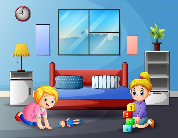Bonitos duas meninas brincando em um quarto