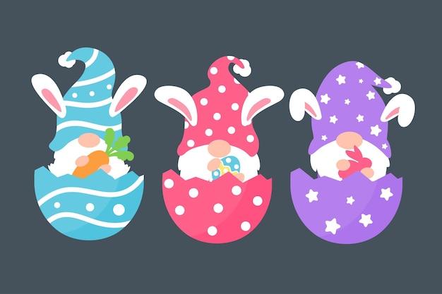 Bonitos gnomos usando orelhas de coelho seguram cenouras e ovos coloridos na páscoa. isolado no fundo