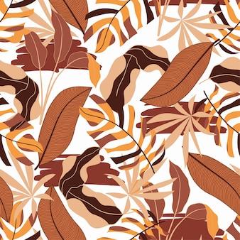 Botânica sem costura padrão tropical com plantas e folhas alaranjadas bonitas