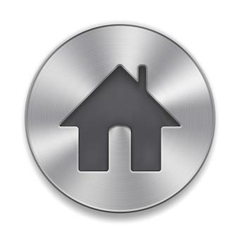 Botão de metal com ícone home em um branco